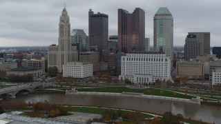 DX0001_002722 - 5.7K stock footage aerial video of approaching the Scioto River and the city skyline, Downtown Columbus, Ohio