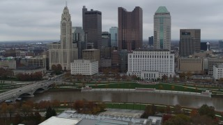 DX0001_002723 - 5.7K stock footage aerial video of a reverse view of the Scioto River and the city skyline, Downtown Columbus, Ohio