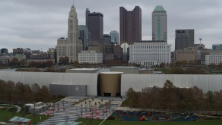 DX0001_002724 - 5.7K stock footage aerial video descend by science museum with view of the city skyline, Downtown Columbus, Ohio