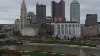 DX0001_002726 - 5.7K stock footage aerial video reverse view of river and city skyline, reveal the science museum, Downtown Columbus, Ohio