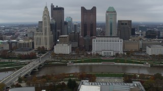 DX0001_002731 - 5.7K stock footage aerial video passing the city's skyline and river near Discovery Bridge, Downtown Columbus, Ohio