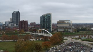 DX0001_002734 - 5.7K stock footage aerial video riverfront condo complex and office building by bridge and river, Downtown Columbus, Ohio