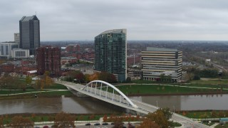 DX0001_002736 - 5.7K stock footage aerial video reverse view of riverfront condo complex and office building by bridge and river, Downtown Columbus, Ohio