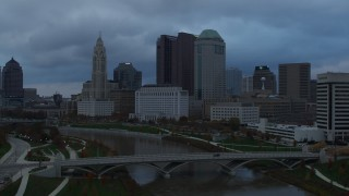 DX0001_002746 - 5.7K stock footage aerial video approach the city skyline from bridges spanning the Scioto River at sunset, Downtown Columbus, Ohio