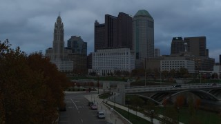 DX0001_002752 - 5.7K stock footage aerial video of the city skyline and the Scioto River at sunset during descent, Downtown Columbus, Ohio