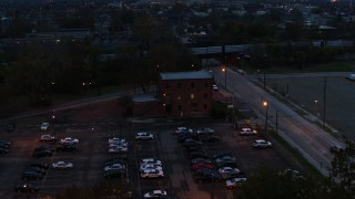 DX0001_002761 - 5.7K stock footage aerial video of orbiting a brick police station at twilight in Columbus, Ohio