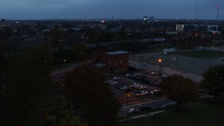 DX0001_002764 - 5.7K stock footage aerial video of approaching a brick police station at twilight in Columbus, Ohio