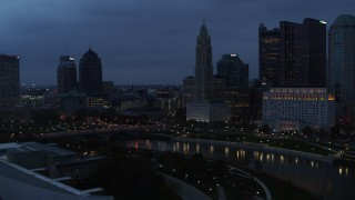 DX0001_002773 - 5.7K stock footage aerial video of a reverse view of LeVeque Tower across the river at twilight, Downtown Columbus, Ohio