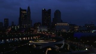 DX0001_002776 - 5.7K stock footage aerial video of the city skyline across the bridge and river at twilight during descent, Downtown Columbus, Ohio