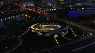 DX0001_002779 - 5.7K stock footage aerial video of orbiting the Veterans Memorial Auditorium at twilight in Columbus, Ohio