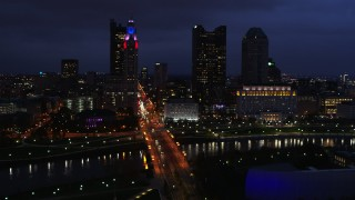 DX0001_002786 - 5.7K stock footage aerial video of flying by the city's skyline across a bridge and river at twilight, Downtown Columbus, Ohio