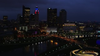 DX0001_002787 - 5.7K stock footage aerial video of passing by the city's skyline across a bridge and river at twilight, Downtown Columbus, Ohio
