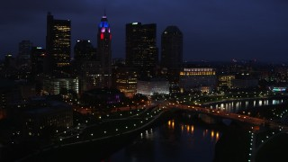 DX0001_002788 - 5.7K stock footage aerial video of  the city's skyline beside a bridge and river at twilight, Downtown Columbus, Ohio