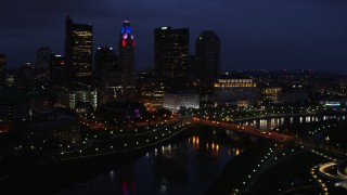 DX0001_002789 - 5.7K stock footage aerial video of the city's skyline and a bridge spanning the river at twilight, Downtown Columbus, Ohio