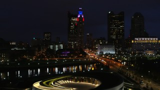 DX0001_002795 - 5.7K stock footage aerial video fly over concert hall by bridge and river to approach skyline at night, Downtown Columbus, Ohio