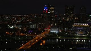 DX0001_002800 - 5.7K stock footage aerial video of LeVeque Tower and bridge spanning the river at night, Downtown Columbus, Ohio