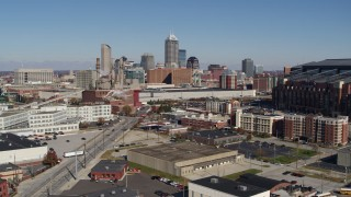 DX0001_002808 - 5.7K stock footage aerial video of the city skyline behind convention center during descent, Downtown Indianapolis, Indiana