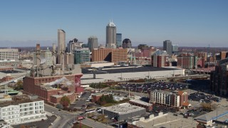 DX0001_002809 - 5.7K stock footage aerial video approach brick factory, convention center and city skyline, Downtown Indianapolis, Indiana