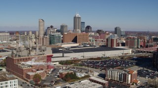DX0001_002810 - 5.7K stock footage aerial video reverse view of brick factory, convention center and city skyline, Downtown Indianapolis, Indiana