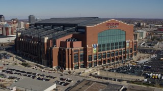 DX0001_002813 - 5.7K stock footage aerial video of a reverse view of a football stadium in Indianapolis, Indiana