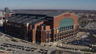 DX0001_002815 - 5.7K stock footage aerial video orbit around a football stadium in Indianapolis, Indiana