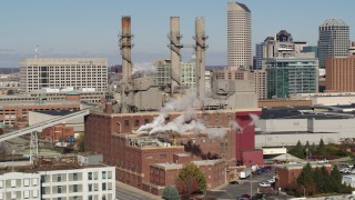 DX0001_002820 - 5.7K stock footage aerial video of flying by brick factory with smoke stacks in Indianapolis, Indiana