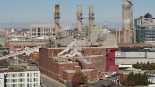 DX0001_002821 - 5.7K stock footage aerial video of passing by brick factory with smoke stacks in Indianapolis, Indiana