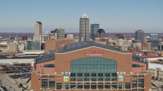 DX0001_002824 - 5.7K stock footage aerial video of flying by the football stadium, ascend to reveal skyline in Downtown Indianapolis, Indiana