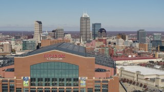 DX0001_002825 - 5.7K stock footage aerial video of flying by the football stadium, with the skyline in the background in Downtown Indianapolis, Indiana