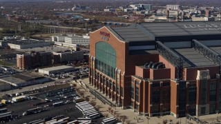 DX0001_002831 - 5.7K stock footage aerial video flying by the front of a football stadium in Indianapolis, Indiana