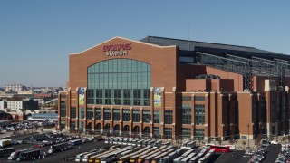 DX0001_002832 - 5.7K stock footage aerial video orbiting the front of a football stadium in Indianapolis, Indiana