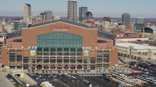 DX0001_002833 - 5.7K stock footage aerial video of an orbit of the front of a football stadium in Indianapolis, Indiana