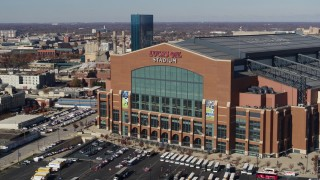 DX0001_002835 - 5.7K stock footage aerial video of ascending in front of a football stadium in Indianapolis, Indiana