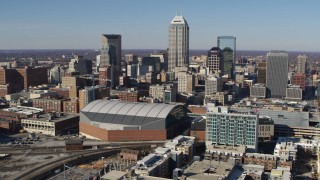 DX0001_002839 - 5.7K stock footage aerial video of a reverse view of the city's skyline in Downtown Indianapolis, Indiana