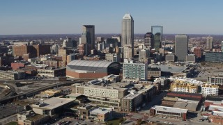 DX0001_002840 - 5.7K stock footage aerial video of flying away from arena and the city's skyline in Downtown Indianapolis, Indiana