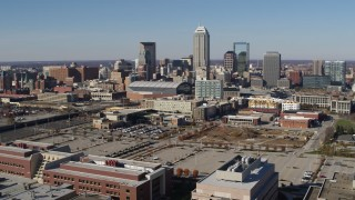 DX0001_002841 - 5.7K stock footage aerial video descend and then approach the city's skyline in Downtown Indianapolis, Indiana