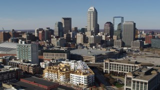 DX0001_002843 - 5.7K stock footage aerial video descend while focusing on the city's skyline in Downtown Indianapolis, Indiana
