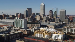 DX0001_002844 - 5.7K stock footage aerial video of focusing on the city's skyline while flying near arena in Downtown Indianapolis, Indiana