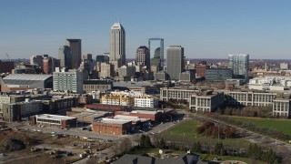 DX0001_002846 - 5.7K stock footage aerial video passing by the city's skyline in Downtown Indianapolis, Indiana