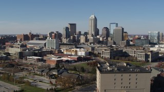 DX0001_002848 - 5.7K stock footage aerial video descend and then approach the city's skyline in Downtown Indianapolis, Indiana