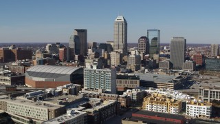 DX0001_002849 - 5.7K stock footage aerial video flying by the city's skyline near the arena in Downtown Indianapolis, Indiana