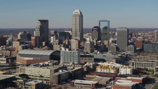 DX0001_002859 - 5.7K stock footage aerial video of slowly approaching tall skyscrapers in the city's skyline in Downtown Indianapolis, Indiana