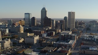 DX0001_002893 - 5.7K stock footage aerial video of passing by the skyline in Downtown Indianapolis, Indiana and ascend