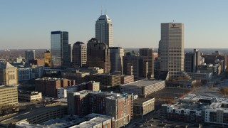 DX0001_002895 - 5.7K stock footage aerial video fly away from the skyline in Downtown Indianapolis, Indiana and descend