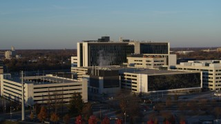 DX0001_002915 - 5.7K stock footage aerial video of flying by a hospital complex at sunset in Indianapolis, Indiana
