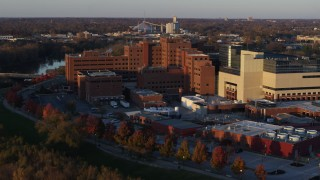 DX0001_002919 - 5.7K stock footage aerial video approach and orbit a VA hospital complex at sunset in Indianapolis, Indiana