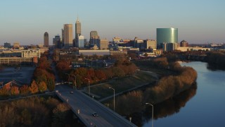 DX0001_002921 - 5.7K stock footage aerial video of the city's skyline seen from the White River at sunset, Downtown Indianapolis, Indiana