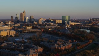DX0001_002928 - 5.7K stock footage aerial video of flying by the city's skyline at sunset, Downtown Indianapolis, Indiana