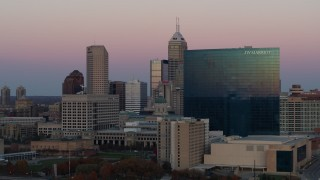 DX0001_002940 - 5.7K stock footage aerial video of flying by hotel to reveal the city's skyline at sunset, Downtown Indianapolis, Indiana