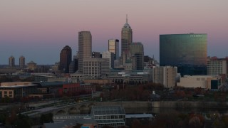 DX0001_002943 - 5.7K stock footage aerial video of descending near hotel and city's skyline at sunset, Downtown Indianapolis, Indiana